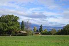 Field near Leman Lake in french Alps, Europe. Royalty Free Stock Photos