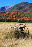Field with Old Farm Equipment and Fall Colors Royalty Free Stock Photos