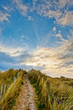 Field path under blue sky in Ireland Stock Photos