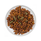 Field Peas And Snapped Green Beans. A plate full of small red peas and snapped green beans on a white background Stock Photo