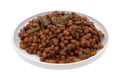 Field Peas And Snapped Green Beans Plate. A plate full of small red peas and snapped green beans on a white background Royalty Free Stock Image