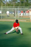 Field practice. A boy in the outfield practicing fielding royalty free stock images