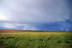 Field and rainbow after storm royalty free stock photography