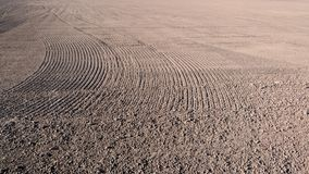 Field ready for planting seeds. Agribusiness and agricultural land processing. The field ready for planting seeds. Agribusiness and agricultural land processing royalty free stock photos