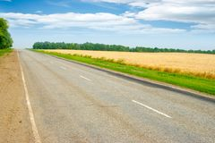 Field and road Royalty Free Stock Images