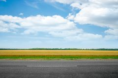 Field and road Royalty Free Stock Photos