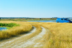 Field road and car Stock Image