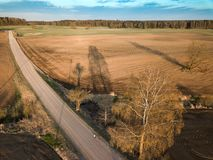 Spring arable land. A field and  road. View from above. A field and  road. Spring arable land.  Aerial view from above Royalty Free Stock Photography