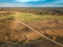 Spring arable land. A field and  road. View from above. A field and  road. Spring arable land.  Aerial view from above Stock Images
