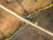 Spring arable land. A field and  road. View from above. A field and  road. Spring arable land.  Aerial view from above Royalty Free Stock Image
