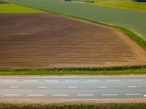 Spring arable land. A field and  road. View from above. A field and  road. Spring arable land.  Aerial view from above Stock Image