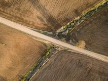 Spring arable land. A field and  road. View from above. A field and  road. Spring arable land.  Aerial view from above Royalty Free Stock Photos