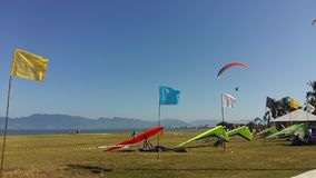 Hang gliders on field Stock Image