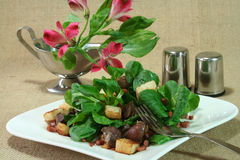 Field salad. Corn salad with fried liver and roasted toast and ham stock images