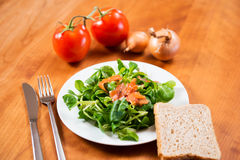 Field salad with carrot, tomato, onion and bread Stock Images