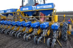In the field of seed drill precision seeding. Zvynyach - Ternopil - Ukraine - April 5, 2017. To work in the field prepared 12 rows of seed precision seeding Stock Image