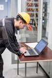 Field service engineer inspect relay protection system with lapt Royalty Free Stock Image