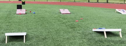 Field set up with cornhole boards for gym classes royalty free stock image