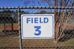 Field 3 sign on chain link fence closeup Royalty Free Stock Photography