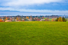 Field and Sky. Field overlooking a Swiss Village by Lake Geneva with the Jura mountain range in the background Stock Image