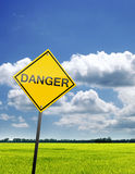 Field and sky with danger sign. Illustration Stock Photos