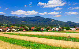 Field and small village in Slovakia against mountains Stock Images