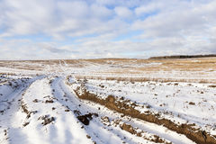 Field with snow, the track Royalty Free Stock Photography
