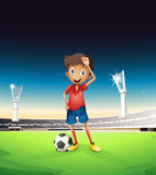 A field with a soccer player in a red uniform. Illustration of a field with a soccer player in a red uniform Royalty Free Stock Photography