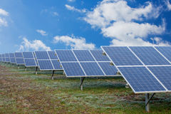 Field with solar cells Royalty Free Stock Images