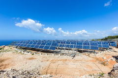 Field of solar collectors on rotatable construction Royalty Free Stock Photography
