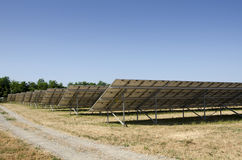 Field of solar panels. Photovoltaic field in Piedmont, Italy Royalty Free Stock Image