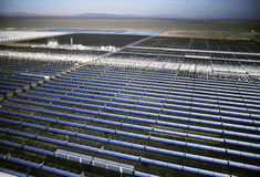 Field Of Solar Panels. Movable Solar panels in the California desert folloow the path of the sun. The heat generated by these miffored surfaces creates steam Royalty Free Stock Photo