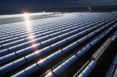 Field Of Solar Panels. Movable Solar panels in the California desert folloow the path of the sun. The heat generated by these miffored surfaces creats steam Royalty Free Stock Photos