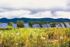 Field of solar panels in Vermont. Throughout Vermont, fields of solar panels spring up like any other crop Royalty Free Stock Photography