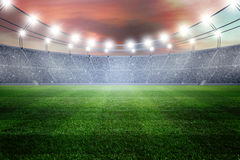 Field of stadium. At sunset Royalty Free Stock Photography