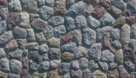 Field Stone Background. A photo of a field stone wall suitable for use as a background. The photo is in a horizontal format Stock Photo