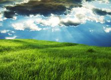 Field and storm clouds stock photography