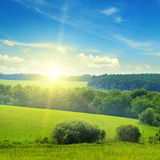 Field, sunrise and blue sky Royalty Free Stock Images