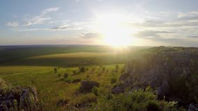 Field before sunset. Timelapse stock video footage
