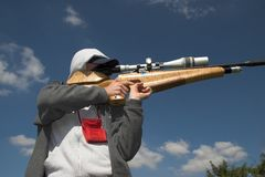 Field target shooter. Competitor taking a shot at a target Royalty Free Stock Photography