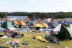 Field and tent village after the rock festival `Smukfest` in Skanderborg, Denmark. Skanderborg, Denmark - August 14, 2017: Field and tent village after the rock Stock Photos