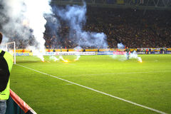 On the field throwing Fire. Dnepropetrovsk - October 10: Stadium Dnipro Arena game playoff qualification of World Cup 2010 between teams of the national teams of Royalty Free Stock Photo