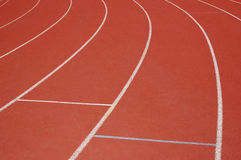 Field Track at the Curb. Field track curving left in orange colors Stock Photos