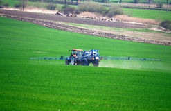 Field tractor sprayer. During spring time Stock Photos