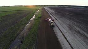 Field Tractor sun aerial stock video