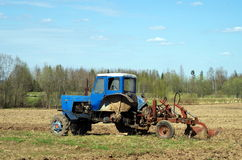 Field tractor. A tractor used for plowing Stock Photos