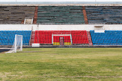 Field and tribunes of abandoned  stadium Royalty Free Stock Images