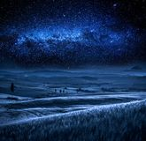 Field in Tuscany at night with milky way, Tuscany, Italy Royalty Free Stock Images