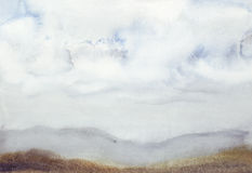 Field under a cloud. Abstract watercolor landscape Stock Photos