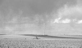 Field Under Storm Clouds, in Black and White Royalty Free Stock Image